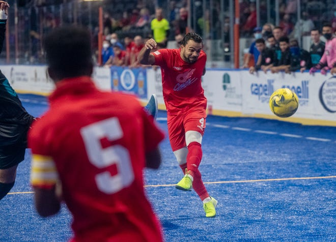 Kansas City Comets forward Kevin Ellis (4) blasts a shot on goal during an MASL Central Cup match against the St. Louis Ambush last December. The Comets will play in the second Central Cup Nov. 12-13 at Cable Dahmer Arena in Independence and The Family Arena in St. Charles, Mo.