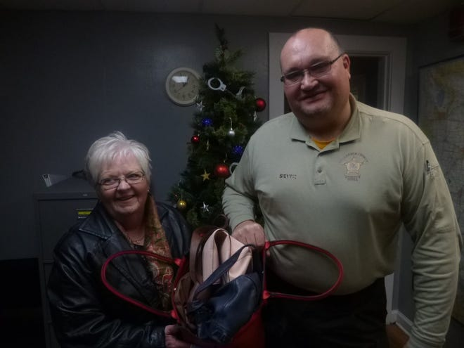 Peg Ingles from Purses with Love is pictured with Henderson County, Illinois, Sheriff Don Seitz.