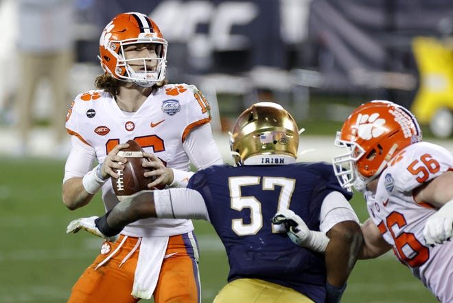 Clemson quarterback Trevor Lawrence (16) looks to pass in the fourth quarter against Notre Dame during the ACC Championship game at Bank of America Stadium in Charlotte, North Carolina, on Saturday, Dec. 19, 2020. Clemson won, 34-10. (Jared C. Tilton/Getty Images/TNS)
