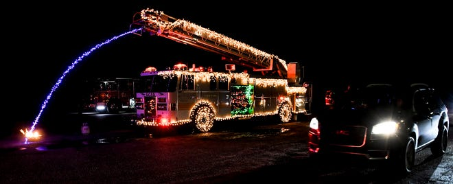 The Garden City Fire Department took part in the reverse Christmas parade Saturday on the Finney County Fairgrounds exhibition parking lot as one of th static floats.  The department decorated one the fire trucks in lights, including a stream of blue lights to represent water putting out a fire.