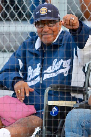 "Galesburg ""superfan"" Pete Thierry acknowledges the cheers of the crowd as he's introduced during Galesburg Legion Post 285's game with Limestone on July 21, 2015. Thierry had recently returned home to Galesburg after a lengthy hospital stay in Peoria."