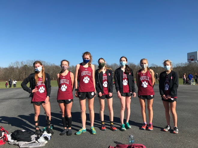 Asheville High's girls cross country team poses after Saturday's meet at Jackson Park. From left to right are Jaiden Bluth, Caitlyn Elliott, Adele Williams , Evan Wilker, Jade Lovio, Mattie Clark Palme and Natalie Nery.