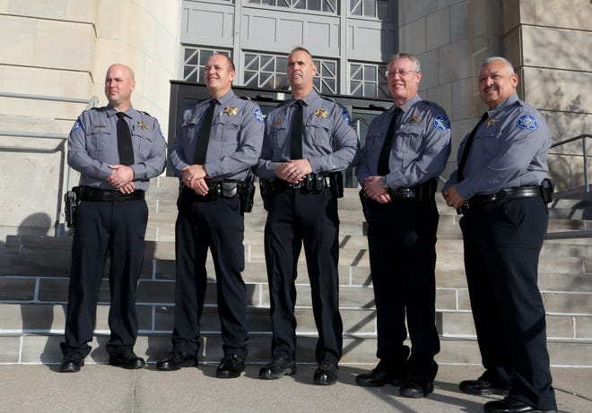 The command staff of the Reno County Sheriff's Office, from left, Jail Capt. Shawn McClay, Patrol Capt. Levi Blumanhourst, Sheriff Darrian Campbell, Undersheriff Shawn McHaley and Detective Capt. Steve Lutz, show off the department's new uniforms on Monday in front of the Reno County Courthouse.