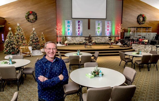 Paul Backhaus, the lead pastor at Trinity Church, stands in the sanctuary of the church at 1901 S. Fourth Ave. in Morton. With popular Christmas services coming up, church leaders have tried to make the environment as safe as possible. Tables for families have been set up at a distance from each other with plenty of hand sanitizer to go around.