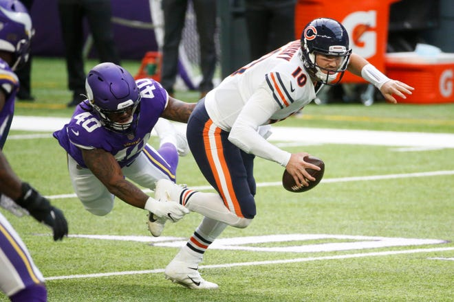 Chicago Bears quarterback Mitchell Trubisky (10) tries to escape Minnesota Vikings linebacker Todd Davis, left, during their game Dec. 20, 2020, in Minneapolis. The Bears beat the Vikings to stay in the playoff race.