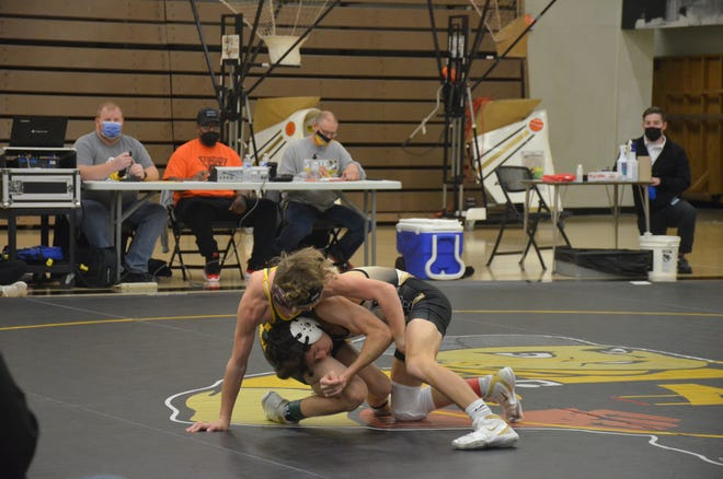 Newton High School's Grant Treaster (white headgear) ran his record to 13-0 on the season at 106 pounds while winning the title at the Bishop Carrroll Invitational Dec. 19. [KANSAN FILE]