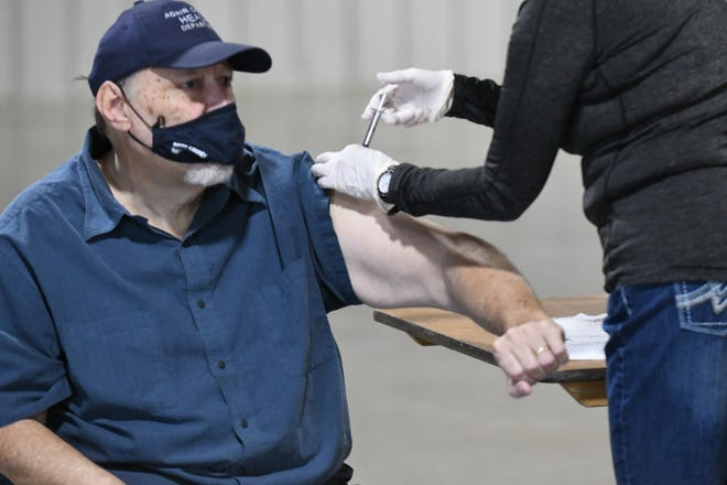 Jim LeBaron, administrator for the Adair County Health Department, receives the COVID-19 vaccine Monday at the NEMO Fairgrounds.