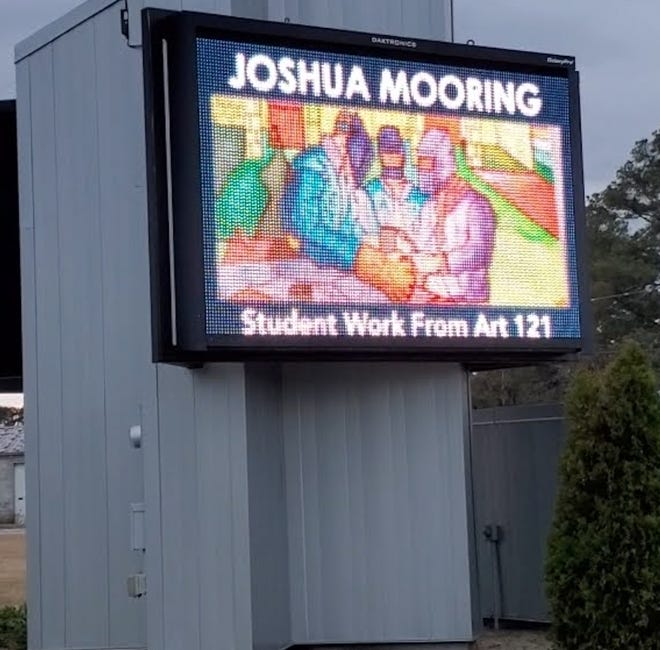 Greene Early College Super Senior, Joshua Mooring, recently had his work spotlighted on LCC's marquee on main campus on Highway 70. The artistic piece was completed in Art 121, taught by Leigh Ann Parrish. This course introduces the elements and principles of design as applied to two-dimensional art. Emphasis is placed on the structural elements, the principles of visual organization, and the theories of color mixing and interaction. Depicting welders, Joshua's interest in the skill of welding inspired the selection of his subject. Joshua has already completed the Basic Welding Skills Certificate and will complete the Intermediate Welding Skills Certificate in May 2021 along with the Associate in Arts Degree from LCC and his high school diploma.[CONTRIBUTED PHOTO]