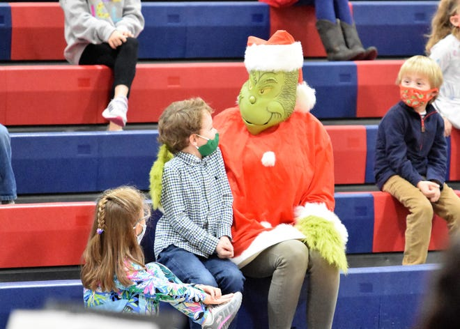 The Grinch greets kindergartener Knox Koonce at Parrott Academy's Holiday Concert held Dec. 4. [CONTRIBUTED PHOTO]