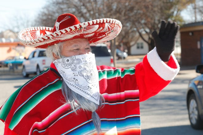Pancho Clos waves to visitors. Pancho Clos greeted people outside of the Maggie Trejo Super Center Sunday, December 20, 2020 on the 49th Anniversary of the Pancho Clos project. One hundred turkeys and 700 fruit bags, donated by local stores and packed by girls in Girl Scout Troop 6073 were given out to the kids and families of that drove by to see Pancho Clos. Over 500 cars came by to see Pancho Clos.