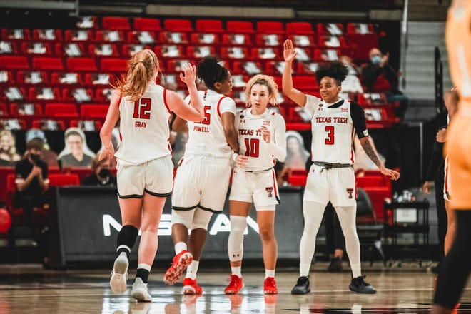 Texas Tech's Vivian Gray, Daija Powell, Naje Murray and Maka Jackson celebrate during a nonconference game Monday, Dec. 21 against Southern University at United Supermarkets Arena.