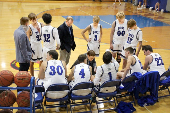 Brookfield High School boys' basketball head coach Carey Davison explains a plan for the Bulldogs during a second-half timeout during their Dec. 14 55-46 come-from-behind home victory over Hamilton: Penney. Both the Bulldogs and Lady Bulldogs are to participate in next Monday's through Wednesday's Bishop LeBlond Holiday Tournament at St. Joseph.