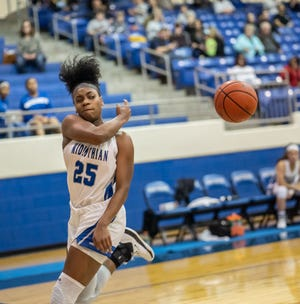Midlothian's Kadia Ward (25) saves the ball inbounds during a home game against Ennis during the 2019-2020 season. The Lady Panthers opened District 14-5A play on Friday night with a 59-34 victory over Joshua.