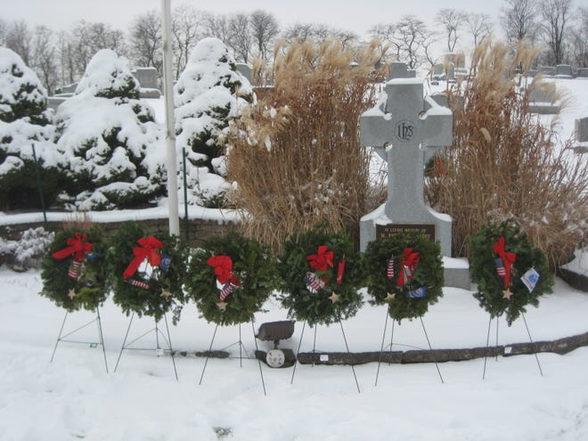 Wreaths were placed under the American flag memorializing the five branches of service, POWs and MIAs. Volunteers placed 630 wreaths on all veteran resting places at St. Patrick's Cemetery, Boughton Hill Cemetery and Victor Village Cemetery.