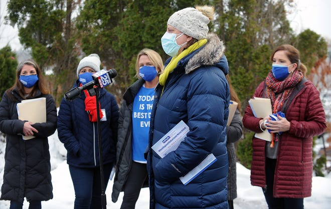 A group of Milford Regional Medical Center nurses held a press conference before they marched from the Portuguese Club to the hospital administration offices Monday announcing their plan to unionize. Pictured speaking is registered nurse Sara Burton.