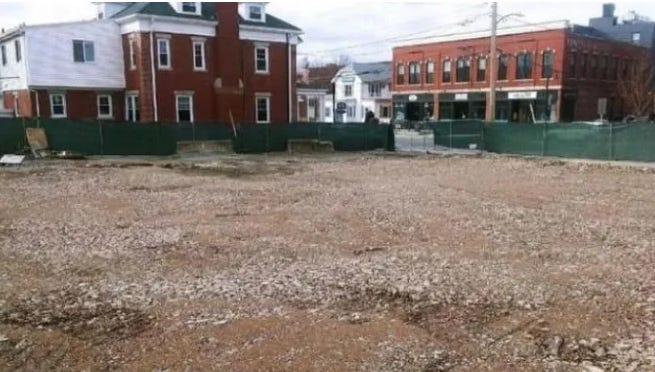 A vacant lot is all that remains from a July 22, 2019 fire that destroyed a business block in downtown Natick.