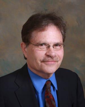 Dr. Jon E. Brett
