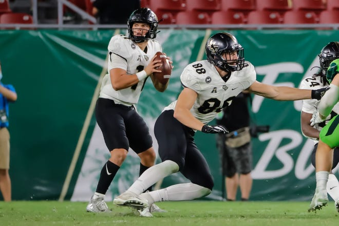 UCF quarterback Dillon Gabriel, passing against South Florida last month, has led an offense that  is second in the nation in yards and sixth in points.