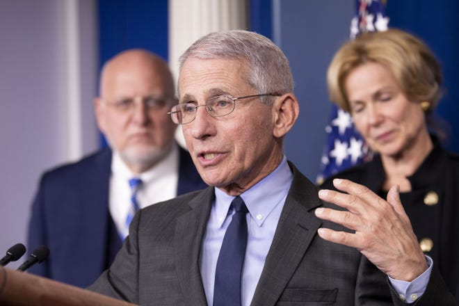 In this file photo from March 2, 2020 shows Anthony Fauci, front, director of the U.S. National Institute of Allergy and Infectious Disease, speaking during a press conference at the White House. Dell Medical School at the University of Texas Austin is giving him the Ken Shine Prize in Health Leadership.