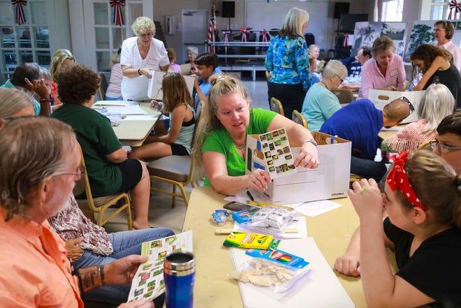 Susan Oyer (center) pictured in 2019 at the Boynton Beach Senior Center.