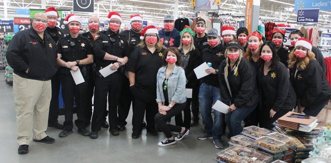 """Among those from the Iberville Parish Sheriff's Office who converged at the Plaquemine Walmart for """"Shop with a Cop"""" were, from left: Sheriff Brett Stassi, Deputy Trevor Alleman, Deputy Chad Martin, Deputy Cody Ash, Deputy Allan Engolio, Deputy Gunnar Ourso, Deputy Dianne Gillis, Detective Jeremy Balcuns, Kalya Callegan, Detective Aubrey St. Angelo, Detective Zane Hebert, Laura Morales, Deputy Brooklyn Marionneaux, Kari McGinnis, McKenzie Wille, Chanta Butler, Gabbe Pupera and Detective Leslie Bradford. In the front row are Leslie Verret and Detective Lori Morgan."""