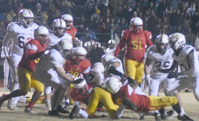 East Iberville and Grand Lake scramble for a loose ball in their Class 1A semifinal title game Dec. 18 in St. Gabriel.