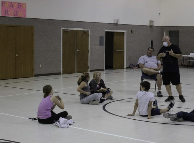 Youth involved with Youth Core Ministries work through life issues with coaches from Greensburg and Pratt communities.