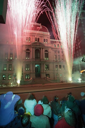 Sparks fly at Providence City Hall — pyrotechnic instead of political — to the delight of the crowd in Kennedy Plaza that gathered to celebrate First Night.