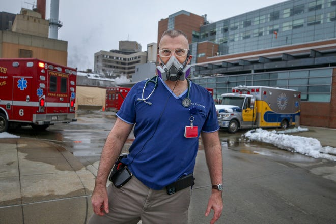 Dr. Whit Fisher outside the emergency-department entrance at Rhode Island Hospital.