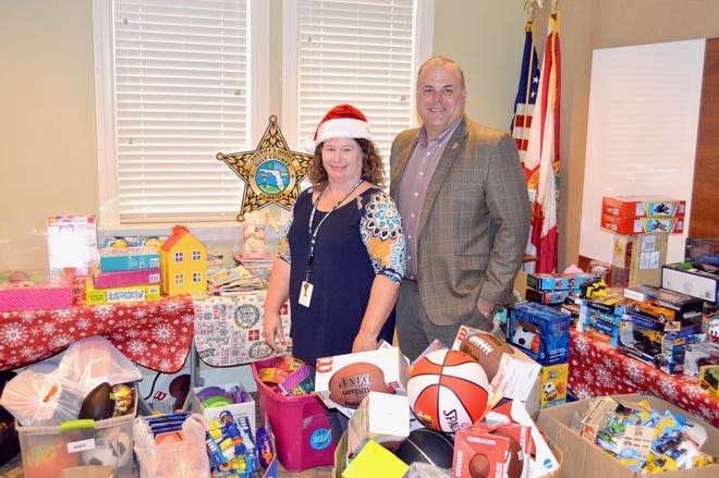 Sheriff Mike Harrison and Officer Margaret Mathis with this year's Christmas Toy Drives toys for delivery before Christmas.