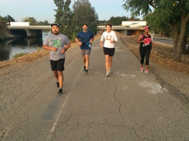 Joggers on the Calaveras River Trail, Stockton.