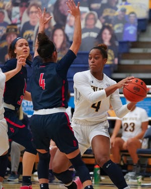 Kent State sophomore forward Nila Blackford looks to pass during Monday's game against Duquesne at the M.A.C. Center.