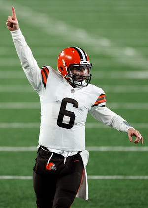 Browns quarterback Baker Mayfield reacts to a touchdown against the New York Giants, Sunday, Dec. 20, 2020, in East Rutherford, N.J. (AP Photo/Adam Hunger)