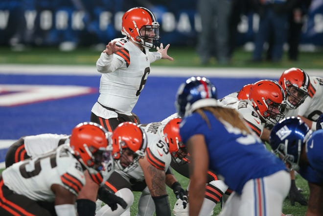 Browns quarterback Baker Mayfield (6) gestures at the line against the New York Giants during the third quarter of Sunday's 20-6 Browns victory in East Rutherford N.J. [Brad Penner/USA TODAY Sports]