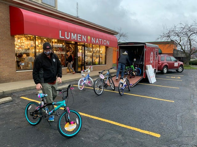Marines load some of the 103 bicycles collected by Lumen Nation in Jackson Township. The business donated the bikes to Toys for Tots. The business worked with customers the Stark Building Industry Association to collect the bikes.