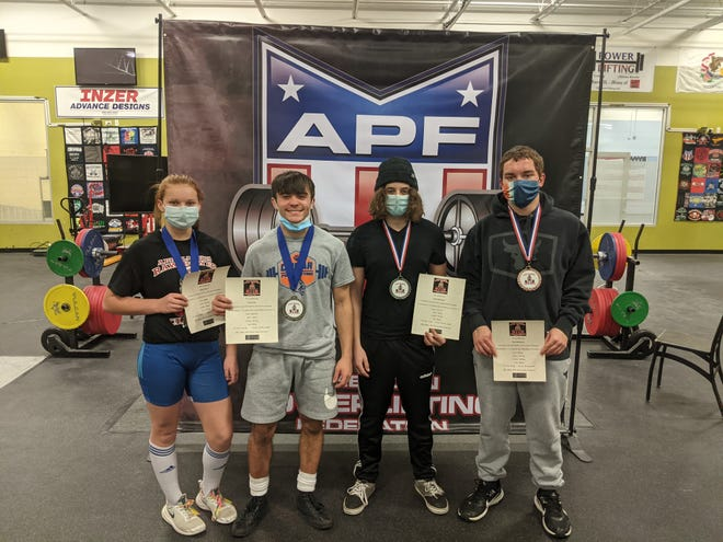 The four members of the Eastland Cougars Powerlifting team that just returned from the Illinois Raw Power Challenge last weekend show off their medals and national record certificates. They are, from left, Natalie Colehour, Cody Cole, Chase Bremmer and Paul Sturtevant.