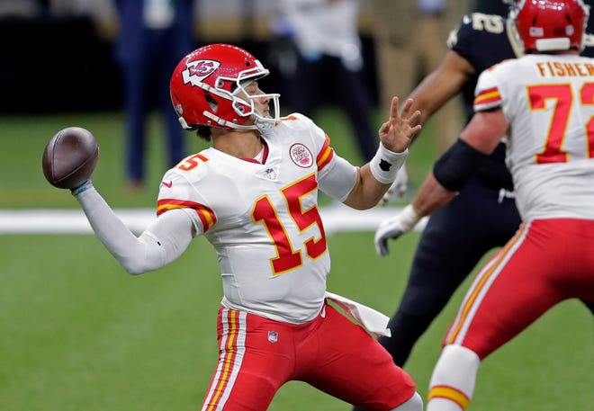 Kansas City Chiefs quarterback Patrick Mahomes (15) makes a throw in the first half against the New Orleans Saints on Sunday in New Orleans.