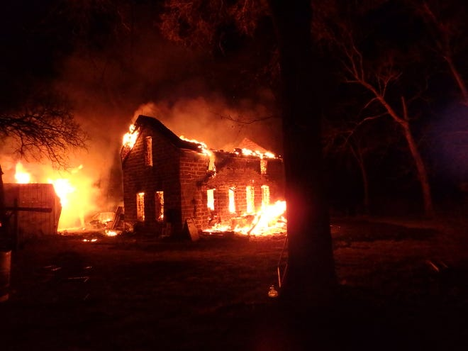 A fire destroyed a two-story farmhouse in rural Saline County Sunday night.