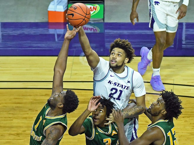 K-State freshman Davion Bradford (21) puts up a shot over three Jacksonville defenders during Monday's game at Bramlage Coliseum.