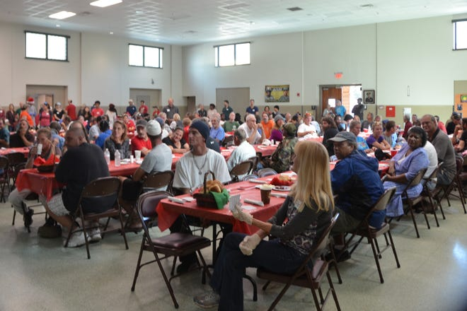 Guests gather during one of the Rick's Family & Friends annual Christmas Celebration Meals.