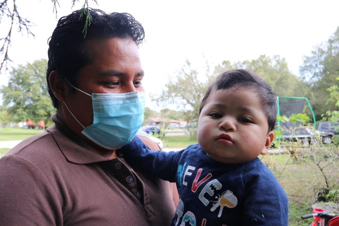 Mario holds his son, Jarel, who had surgery on his heart and trachea at just 6 months old.