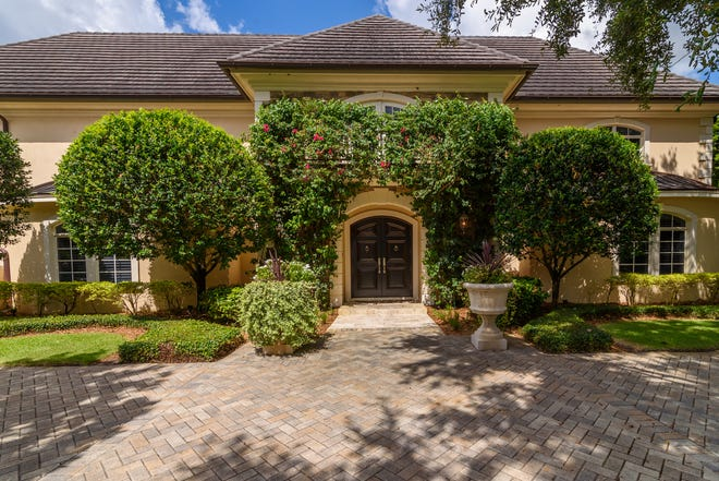 Situated in Sarasota's South Poinsettia Park amid leafy streets named for flowers, a chateau-like compound at 1807 Oleander Street is setting a neighborhood standard for curb appeal while offering 9,492-square-feet of European sophistication is on the market for $4,399,000. (Photo / Gianfranco Spagnolo)