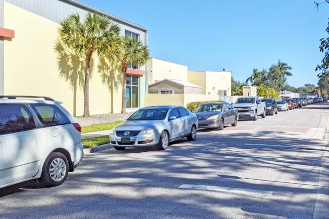 Approximately 50 cars waited in line to enter the parking lot at the Robert L. Taylor Community Complex on Monday afternoon to receive COVID-19 testing after the county's only drive-thru site was suddenly closed on Sunday.