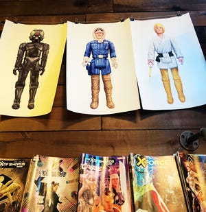 Action figure prints from a local artist at Odin & Sons.