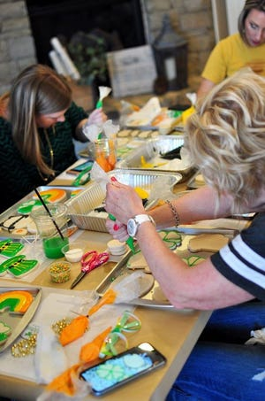 North Rock Creek counselor Ashley Moody teaching one of her cookie decorating classes last year.