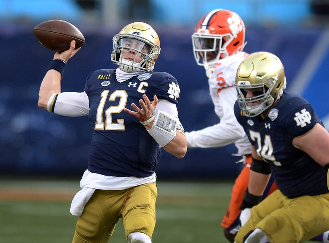Notre Dame quarterback Ian Book throws a pass against Clemson during the Atlantic Coast Conference championship NCAA college football game, Saturday in Charlotte, N.C.