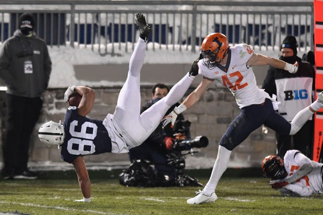 Penn State tight end Brenton Strange (86) scores a third quarter touchdown as Illinois defensive back Michael Marchese (42) defends Saturday in State College, Pa.