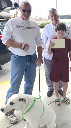 Instead of gifts for his birthday, Jace Pilney collected donations for Adopt an Angel in honor of Lexus, the rescue dog his family adopted.