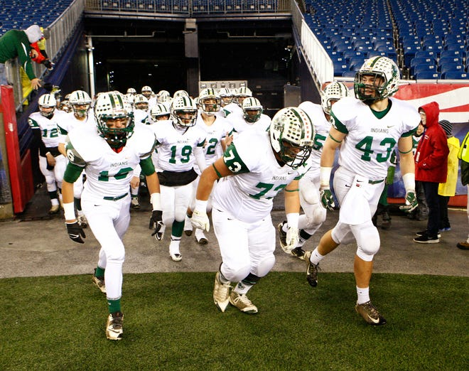The Dartmouth Indians come out of the tunnel and out onto the Gillette Stadium field for their game against Melrose.