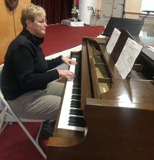 Ann Rich, who had been running a regional music program for the Salvation Army, now assists at the New Bedford headquarters, but still finds time at the piano.